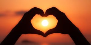 f22-160214-heart-hands-sunset